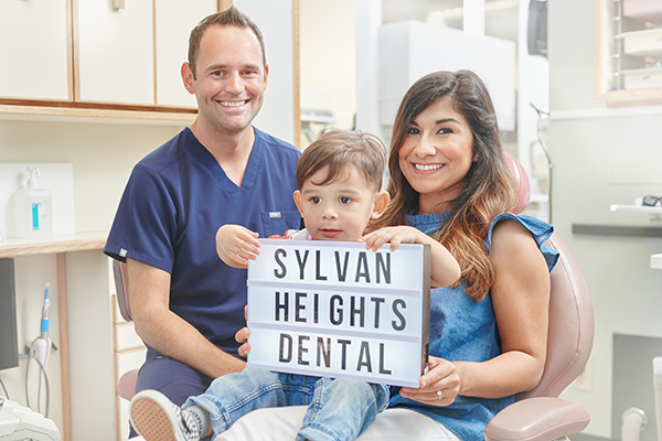 Dr. Jeremiah Leary from Sylvan Heights Dental with happy patient.
