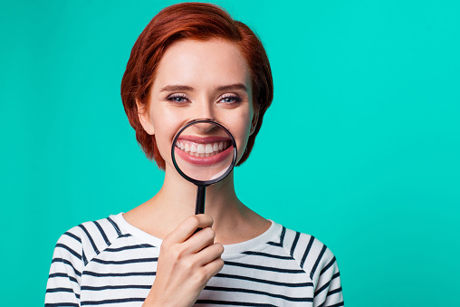 Image of a woman smiling after getting dental bonding at Sylvan Heights Dental in Portland, OR